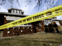 "Crime scene tape surrounds a home on Sunday, Feb. 7, 2016, in Chicago. Police said they believe six family members found dead in their southwest side home were killed in a ""targeted incident,"" though they're still trying to determine a possible motive. (AP Photo/Nam Y. Huh)"