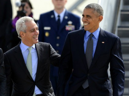 President Barack Obama right, talks with Chicago Mayor Rahm Emanuel left, after walking off Air Force One while arriving at O'Hare International Airport Friday, Oct. 7, 2016, in Chicago. (AP Photo/Paul Beaty)