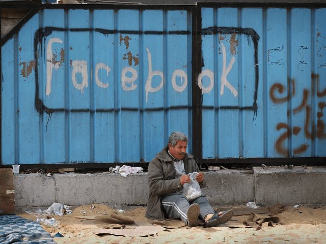 CAIRO, EGYPT - FEBRUARY 04: A fence is spray painted with the word Facebook in Tahrir Square on February 4, 2011 in Cairo, Egypt. Anti-government protesters have called today 'The day of departure'. Thousands have again gathered in Tahrir Square calling for Egyptian President Hosni Mubarak to step down. (Photo …