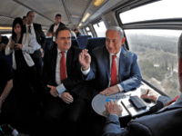 Israeli Prime Minister Benjamin Netanyahu (R) sits next to Israel's Transportation and Intelligence Minister Yisrael Katz during a test-run of the new high-speed train between Jerusalem and Tel Aviv, near Lod and Ben Gurion international Airport, on September 20, 2018. (Photo by Thomas COEX / AFP) (Photo credit should read …