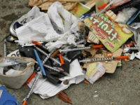 File - In this Feb. 26, 2016, file photo, a number of syringes are scattered in the remains of a tent city being cleared by city workers along Division Street in San Francisco. The mayor of San Francisco says he is hiring 10 workers whose sole responsibility will be to …