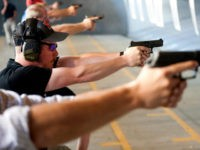 John MacFarlane, a Colorado high school physics teacher from Colorado school District 20, fires his gun during a firearms course for school teachers and administrators offered by FASTER Colorado at Flatrock Training Center in Commerce City, Colorado on June 26, 2018. - FASTER Colorado has been sponsoring firearms training to …
