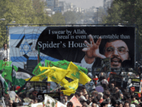 Iranian protestors, holding up a huge banner with the picture of Lebanon's Hezbollah leader Hassan Nasrallah and waving yellow flags of the Shiite Muslim guerrilla group, take part in a demonstration held in Tehran to mark Jerusalem (Al-Quds) Day, 20 October 2006. Iranian President Mahmoud Ahmadinejad said in a speech …