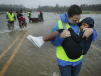 Volunteers from the Civilian Crisis Response Team help rescue three children from their flooded home September 14, 2018 in James City, United States. Hurricane Florence made landfall in North Carolina as a Category 1 storm and flooding from the heavy rain is forcing hundreds of people to call for emergency …