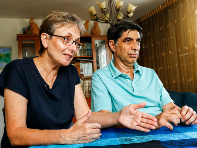 Leah (L) and Simha (R) Goldin, the parents of Israeli soldier Lieutenant Hadar Goldin, speak during an interview with AFP at their family home in the central Israeli city of Kfar Saba on August 29, 2018. - From the living room of their home in central Israel, surrounded by books …