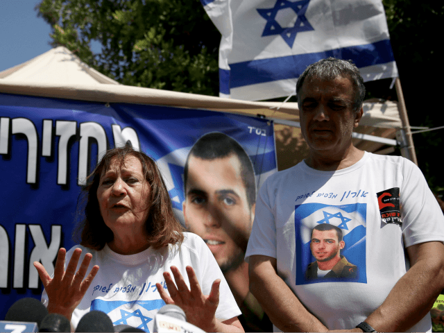 Israeli Zehava Shaul, the mother of slain Israeli soldier Oron Shaul, who was killed in Gaza during the summer of 2014's 50-day military campaign against Hamas and body's has not been recovered, speaks during a press conference on June 29, 2016 next to her husband Herzel (R) at their protest …