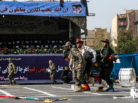 This picture taken on September 22, 2018 in the southwestern Iranian city of Ahvaz shows Iranian soldiers carrying away an injured comrade at the scene of an attack on a military parade that was marking the anniversary of the outbreak of its devastating 1980-1988 war with Saddam Hussein's Iraq. - …
