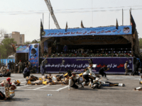 This picture taken on September 22, 2018 in the southwestern Iranian city of Ahvaz shows injured soldiers lying on the ground at the scene of an attack on a military parade that was marking the anniversary of the outbreak of its devastating 1980-1988 war with Saddam Hussein's Iraq. - Dozens …
