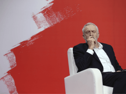 Jeremy Corbyn, leader of Britain's Labour Party, listens to speakers during the Party of European Socialists Council in Lisbon, Saturday, Dec. 2 2017. (AP Photo/Armando Franca)