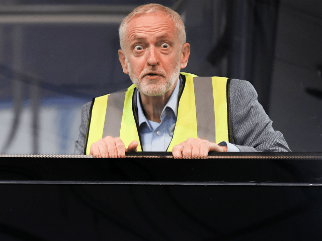 FALKIRK, SCOTLAND - AUGUST 20: Labour leader Jeremy Corbyn and Scottish Labour Leader Richard Leonard campaign on Labour's 'Build it in Britain' policy at Alexander Dennis bus manufacturers on August 20, 2018 in Falkirk,Scotland. The Labour leader will spend the next four days in Scotland in an attempt to revitalize …