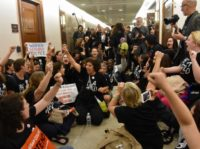PHOTOS: Protesters Storm Lawmakers' Offices to Condemn Kavanaugh