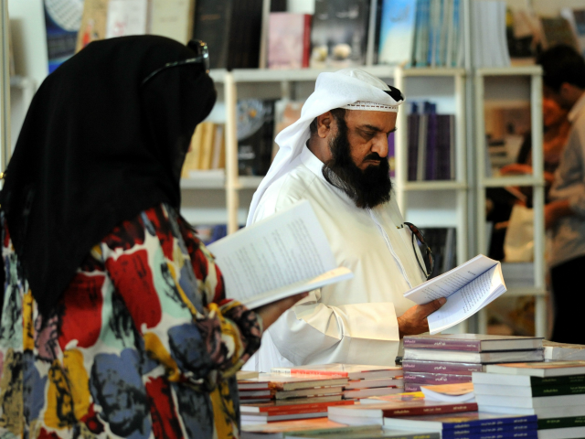 Visitors look at exhibits during the 35th Kuwait International Book Fair on Thursday, October 14, 2010 in Mishref Fair Grounds, Kuwait. This year's edition of the fair is surrounded by controversy over the amount of censorship applied by the government on publishers. (AP Photo/Gustavo Ferrari)
