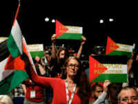 Delegates wave Palestinian flags during a speech about the situation in Palestine on day three of the Labour Party Conference on September 25, 2018 in Liverpool, England. The four-day annual Labour Party Conference takes place at the Arena and Convention Centre in Liverpool and is expected to attract thousands of …