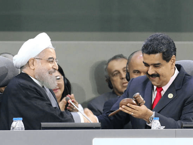 Handout picture released by the Venezuelan presidency showing Iranian President Hassan Rouhani (L) and Venezuelan President Nicolas Maduro talk during the opening ceremony of the Non-Aligned Movement summit in Porlamar, Margarita Island, Venezuela, on September 17, 2016 With the left increasingly isolated by a crushing political and economic crisis, Venezuela …