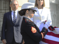Marines fold the American flag in front of Hungarian Interior Minister Sandor Pinter, left, and US Ambassador to Hungary Coleen Bell during a commemoration to mark the 15th anniversary of the terrorist attacks in New York and Washington, DC in front of the US Embassy building in Budapest, Hungary, Sunday, …