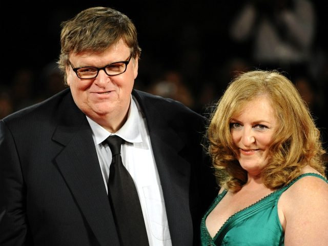 US director Michael Mooreand his wife Kathleen Glynn arrive for the screening of 'Capitalism: A love story' at the Venice film festival on September 6, 2009. 'Capitalism: A love story' is competing for the Golden Lion of the 66th Mostra Internationale d'Arte Cinematografica, the Venice film festival. AFP PHOTO / …