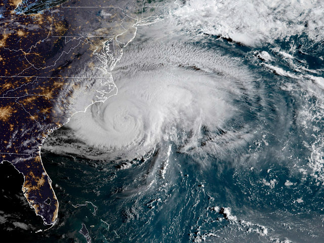 This satellite image provided by NOAA shows Hurricane Florence off the eastern coast of the United States on Thursday, Sept. 13, 2018. (NOAA via AP)