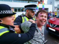 GLASGOW, SCOTLAND - AUGUST 19: Police arrest people protesting that the police were allowed to leadthe march at Glasgow Pride on August 19, 2017 in Glasgow, Scotland. The largest festival of LGBTI celebration in Scotland has been held every year in Glasgow since 1996. (Photo by Robert Perry/Getty Images)