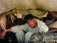 Afghan refugees hide in the back of a truck as they sneak into Xahedan, a city in south Iran on the border with neighboring Afghanistan as allied forces bomb Afghanistan, October 8, 2001. Iranian security forces believe that more refugees will take refuge from the ruling Taliban regime in Afghanistan, …