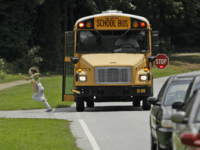 Stoparm cameras intended to catch drivers who illegally passes buses that are picking up or unloading children aren't working in Virginia. A glitch in state prevents the camera tickets from being delivered by mail. Several state lawmakers have proposed bills that would change that. (AP/David Goldman)