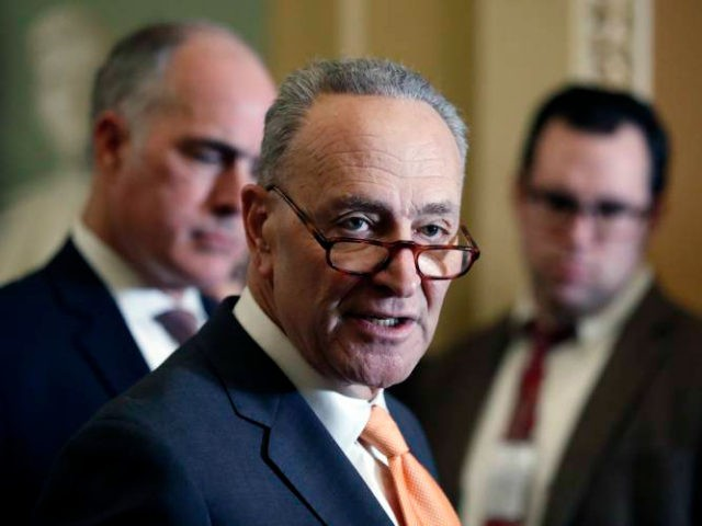 Senate Minority Leader Chuck Schumer of N.Y., center, accompanied by Sen. Bob Casey, D-Pa., at left, speaks on Capitol Hill, Tuesday, Feb. 6, 2018 in Washington. (AP Photo/Alex Brandon)