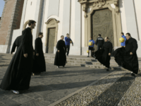 "Clerics of the soccer team ""priests Selecao"" practice with soccer balls as they wait outside the St.Paul and Peter's church in Arluno, near Milan, Italy, prior to a training session in the nearby church playground, Thursday, Feb. 2, 2007. Moreno Buccianti, a 50-years-old amateur soccer coach from Tuscany, together with …"