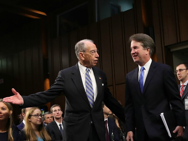 WASHINGTON, DC - SEPTEMBER 05: Senate Judiciary Committee Chairman Chuck Grassley (L) (R-IA) leads Supreme Court nominee Judge Brett Kavanaugh (R) to the witness table at the beginning of Kavanaugh's second day of his confirmation hearing on Capitol Hill September 5, 2018 in Washington, DC. Kavanaugh was nominated by President …