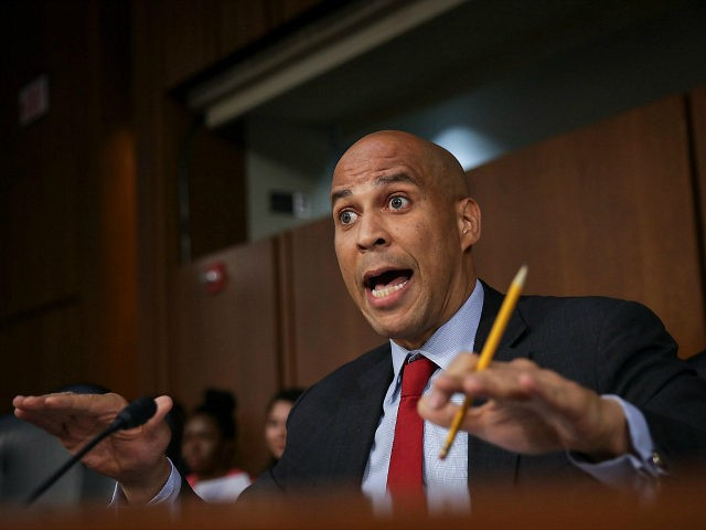 WASHINGTON, DC - SEPTEMBER 6: Sen. Cory Booker (D-NJ) questions Supreme Court nominee Judge Brett Kavanaugh before the Senate Judiciary Committee on the third day of his Supreme Court confirmation hearing on Capitol Hill September 6, 2018 in Washington, DC. Kavanaugh was nominated by President Donald Trump to fill the …