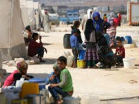 People who fled Syria's Idlib province are pictured at a camp in Kafr Lusin near the border with Turkey in the northern part of the province on September 9, 2018. - Regime and Russian air raids pounded Syria's last major rebel bastion of Idlib today after an overnight lull, killing …
