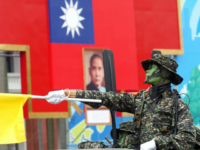 A soldier from one of Taiwan's elite special operation units, salutes atop a military truck as it passes through Taipei's presidential office square 10 October 2007 during the first military parade in 16 years. Taiwan flexed its military muscles in the National Day celebrations, showing off two home-developed missiles in …