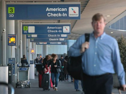 CHICAGO, IL - NOVEMBER 30: Passengers arrive for American Airlines flights at O'Hare International Airport on November 30, 2017 in Chicago, Illinois. American Airlines was offering incentives to entice pilots to fly during the busy Christmas holiday travel period after a computer glitch mistakenly granted too many pilots time off …