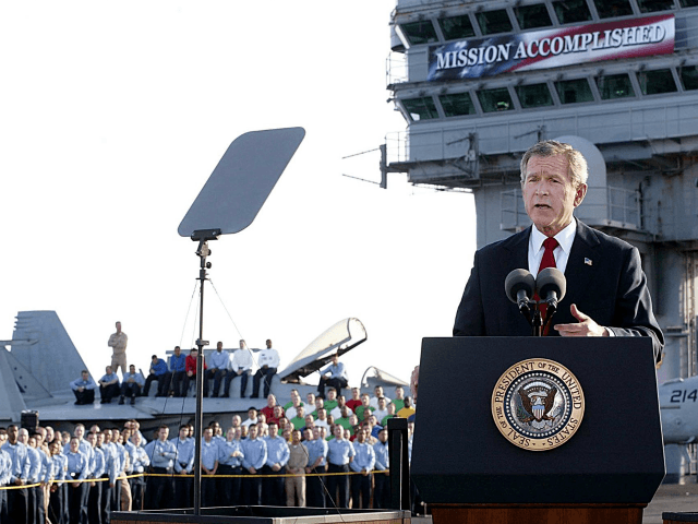 US President George W. Bush addresses the nation aboard the nuclear aircraft carrier USS Abraham Lincoln 01 May, 2003, as it sails for Naval Air Station North Island, San Diego, California. Bush declared major fighting over in Iraq, calling it 'one victory in a war on terror' which he said …