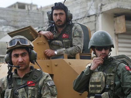FILE - In this March 24, 2018 file photo, Turkish soldiers atop an armored personnel carrier secure the streets of the northwestern city of Afrin, Syria, during a Turkish government-organized media tour into northern Syria. Turkey is growing long-term roots in its northern Syrian enclave, nearly two years after its …
