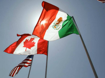 The flags of the United States, Canada and Mexico fly in the breeze at the Louis Armstrong International Airport Monday, April 21, 2008 in New Orleans. The three heads of state, U.S. President Bush, Canadian Prime Minister Stephen Harper, and Mexican President Felipe Calderon, are attending the fourth annual North …