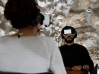 Visitors wear virtual reality headsets as they experience a new virtual reality 360° tour depicting the Jewish Second Temple as it was two millennia ago before it was destroyed, at a visitors' centre in the covered part of the Western Wall in the Jerusalem's Old City, on February 23, 2017. …