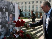 Crimean leader Sergei Aksyonov lays flowers at the improvised memorial to Alexander Zakharchenko, the 42-year-old head of the self-proclaimed Donetsk People's Republic, who was killed in a bombing in the rebel-controlled city of Donetsk on Friday