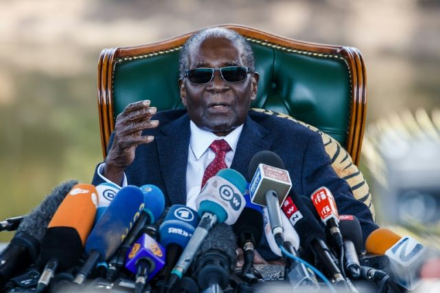 Zimbabwe's Mugabe accepts disputed election result