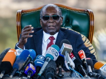 """Former Zimbabwean President Robert Mugabe addresses media on July 29 during a surprise press conference at his residence """"Blue Roof """" in Harare"""