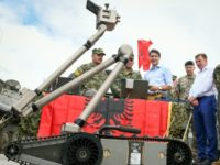 Canadian Prime Minister Justin Trudeau, center, inspects a military robot deployed with NATO troops in Latvia in July 2018