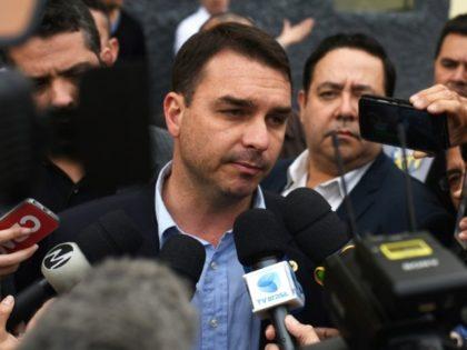 Flavio Bolsonaro, son of the frontrunner in Brazil's presidential contest, speaks to the media