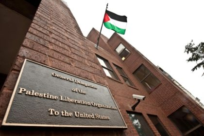 The Palestinian flag flies from the building housing the General Delegation of the Palestine Liberation Organization in Washington on January 18, 2011