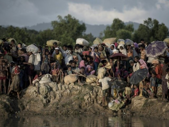 File photo taken on October 10, 2017 shows Rohingya refugees arriving at the Naf river on the Bangladesh border