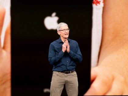 Apple, whose CEO Tim Cook is seen here at the September 12 iPhone launch event, won't face an immediate impact from new tariffs on Chinese-made goods