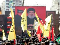 Supporters of Lebanon's Shiite movement Hezbollah gather near a giant poster of their leader Hassan Nasrallah during a ceremony to mark Ashura in Beirut on September 20, 2018