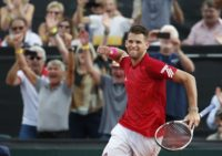 Austria's Dominic Thiem celebrates after playing Australia's Alex De Minaur during the Davis Cup Playoff September 16, 2018