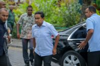 Maldives President Abdulla Yameen (C) arrives at a polling station to vote in a controversial election that foreign observers have claimed is rigged in the strongman's favour