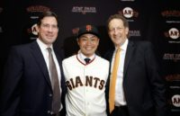 Bobby Evans (left), seen here after signing Norichika Aoki in 2015, has been relieved of his duties as general manager of the San Francisco Giants