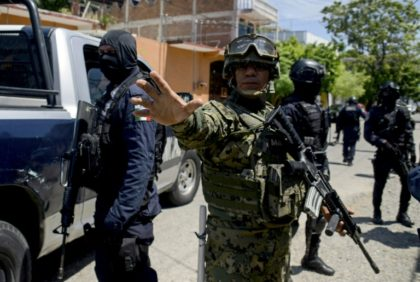 Fearing the Acapulco police force had been infiltrated by drug cartels, Mexican marines, together with state and federal police, deployed in a massive ground and air operation around the Pacific coast city's police headquarters