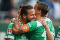 Werder Bremen's Austrian forward Martin Harnik (L) celebrates after scoring the opening goal in Tuesday's 2-1 win which put his team second in the German league table.
