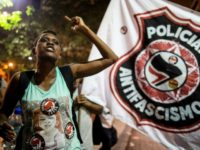 Demonstrators in Rio de Janeiro were among the hundreds of thousands who protested in dozens of Brazilian cities against right-wing presidential candidate Jair Bolsonaro